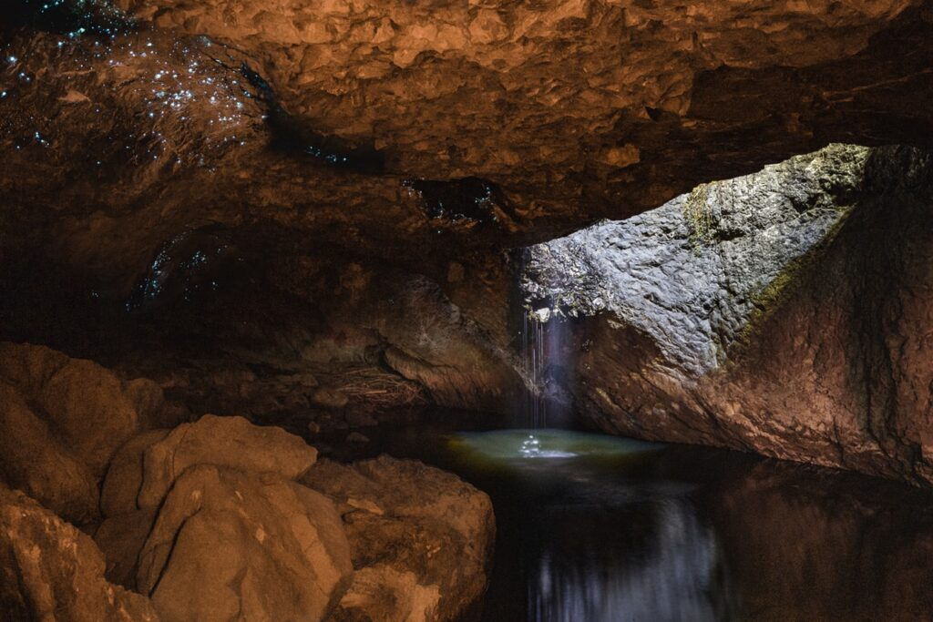 Photo of a cave with a body of water